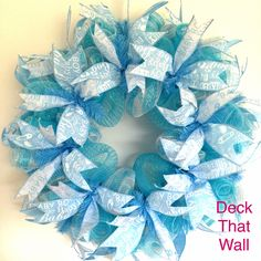 This cute Baby Boy wreath is made with two different styles of mesh, featuring a light blue and a light blue with white stripe. There are two different wired ribbons used throughout the wreath, both f