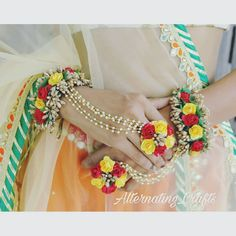 Beautiful Red Yellow Haath Phool for Wedding Function - Floral Jewelry Store Flower Jewellery For Haldi, Indian Wedding Jewelry, Bridal Jewelry, Beaded Jewelry, Diy Jewellery, Flower Jewelry, Flower Bracelet, Flower Necklace, Flower Ornaments