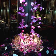 Harry Slatkin of candle firm Slatkin & Company created a luscious cascade of purple orchids that hung at various lengths—including...