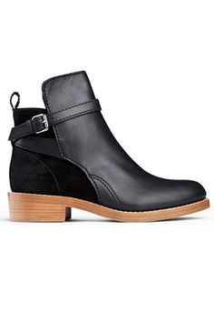Acne Clover Black Boots, $560, available at Acne. Perfect Flat Boots To Conquer Any Hill #refinery29
