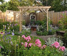 """gardening """"room"""" created with an arbor, an antique fire box, an old chandlier and perennials (purple coneflower, coreopsis, phlox and lamb's ears)"""