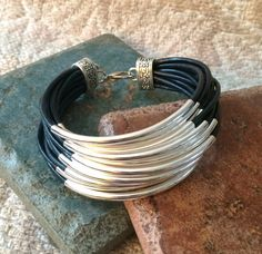Multi Strand Leather & Silver Curved Tube by GrecoGirlJewelry
