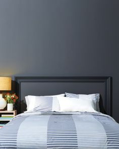 You can visually anchor your bed with a faux-headboard that's easy -- and inexpensive -- to put together. The trick: window- or door-casing molding, available at any home center or hardware store. The length of each strip will depend on the width and size of the bed. Here, we created a 48-by-70-inch frame for a queen-size bed, using three 5-inch-wide strips (the vertical strips should reach the baseboards). Cut the strips to size with a miter box and saw. Tack them in place every six inches…