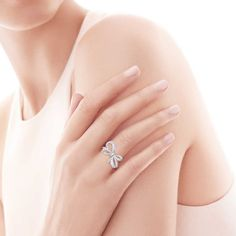 Ribbon bow ring in platinum with round brilliant diamonds.   Tiffany & Co.