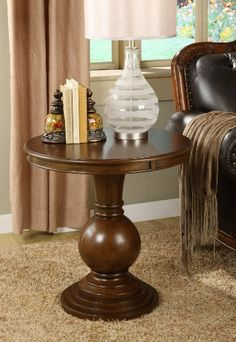 """Powell Cherry Round Accent Table by Powell. $194.00. Will complement any decor. Interesting round ball designed bottom. Some assembly required. Rich """"merlot"""" finish. Perfect piece for an entryway or any other room in your house. The Cherry Round Accent Table features an interesting round ball designed bottom. A rich """"Cherry"""" finish, this piece adds instant elegance to any room. The perfect piece of furniture to add a bit of elegance to an entryway or any other room in your home. ..."""