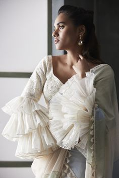 This season ruffle sleeves and bell sleeves saree blouse designs are in trend and you can't just ignore them. Take a look at some of the amazing bell sleeves and ruffle sleeves blouse designs that you can add to your wardrobe. Blouse Back Neck Designs, White Blouse Designs, Bridal Blouse Designs, Saree Blouse Patterns, Designer Blouse Patterns, Saree Blouse Designs, Designer Blouses For Lehenga, Ruffles, Stylish Blouse Design