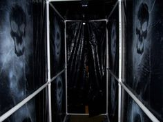 For those of you who don't want to tape/pin/staple things to your walls... PVC spooky hallway