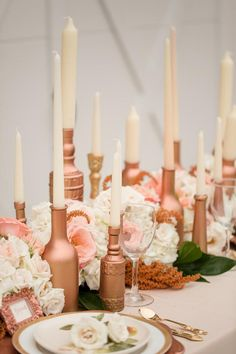 Rose gold candleholders and plush white blooms make a sweet yet striking tablescape statement.