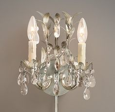 Vintage Vine Double Sconce  These would probably be easier to pull off then a full chandelier and they have a great fairy look to them.