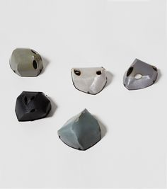 """Bunkers & Masks I – V"" by Samira Götz. 2015. Cement, laquer, copper, steel."