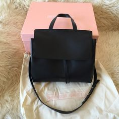 Authentic Mansur Gavriel Black Flamma Red Lady Bag This is the highly coveted, sold out Mansur Gavriel Lady Bag (not large). Purchased directly from the Mansur Gavriel website before it was sold out in an hour in fall 2015. Comes with original box, tags, and I can provide the receipt/invoice to prove authenticity. Carried once, otherwise brand new! As all vegetable tanned leather MG bags, it is not meant to remain pristine and sleek -  scratching and wear will occur. It came with some…