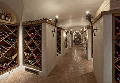 """Joe Montana's Home Wine Cellar (""""Villa Montana""""). Love the castle-like feel to the floor & torch sconces. Napa Style, Home Wine Cellars, Montana Homes, Devine Design, Joe Montana, Mediterranean Style Homes, Old World Style, Country Estate, Bar"""