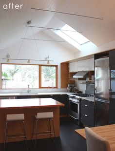 Basically I am in love with this kitchen & wish we had vaulted our ceilings when we remodeled a million years ago.