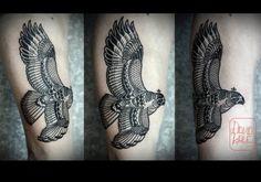 Black and white falcon tattoo