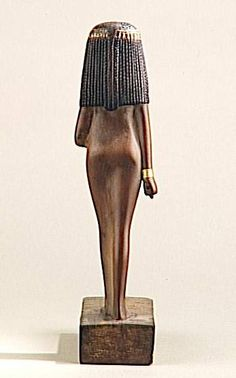 Wood statue of Lady Nay, painted and gilded. 18th dynasty (1550-1295). Inventory # N871 1400BC. Musée du Louvre, Paris.