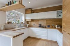 White kitchen with wood accents - Little Piece Of Me