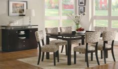 Coaster Libby-DinSet Libby Dining Set by Coaster Home Furnishings. $655.00. Libby Dining Set by Coaster Libby-DinSet. Crafted from poplar solids and birch veneers with straight clean lines accentuated by subtle curves on the chair back and a stunning floating top, this group makes a statement in your dining room. Dining set has a dark cappuccino finish with a vibrant patterned upholstered chair. Matching server features matching floating top, storage cabinets and dr...