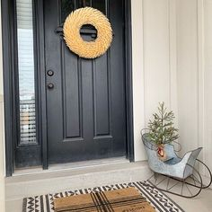 Image may contain: plant Entrance Decor, Winter Time, Front Porch, Farmhouse Decor, Garage Doors, Plant, Outdoor Decor, Image, Instagram