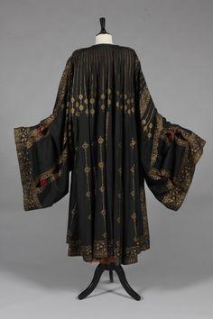A fine and rare Mariano Fortuny stencilled orientalist black silk evening coat, circa 1910-20