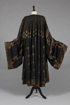 A fine and rare Mariano Fortuny stencilled orientalist black silk evening coat, circa 1910-20