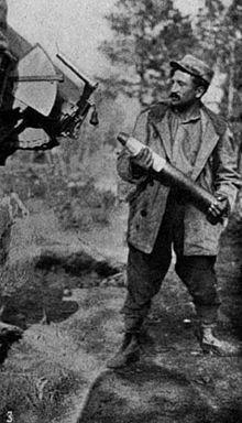 "WW1. "" An artilleryman putting a time shell into the breech of an anti-aircraft '75', which, although mounted on an automobile, fires twenty-eight shots a minute."" ~Julien Bryan - Ambulance 646"