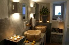 Romantic and Cozy: Cozy bathroom with organic shapes and textures. Layered lighting creates the mood.