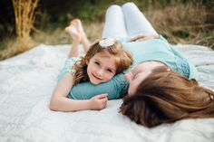 Beautiful mother and daughter pose. Child pose.