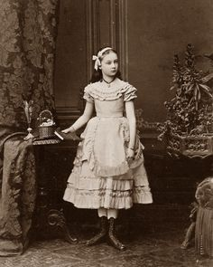 Girl posing with book 1870s