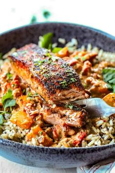Blackened Salmon in Creamy Cajun Sauce - far away iew of pan seared blackned salmon on rice in black bowl with sauce Salmon Recipe Pan, Baked Salmon Recipes, Fish Recipes, Seafood Recipes, Dinner Recipes, Cooking Recipes, Healthy Recipes, Entree Recipes, Recipes