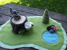 Wool Playmat with pond,  rocks, and mouse, stump, mushrooms, and tree.