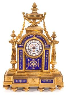 A FRENCH LOUIS XVI-STYLE GILT BRONZE AND ENAMEL MANTEL CLOCK