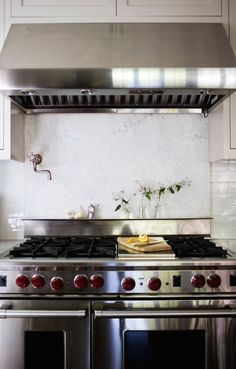 Wolf Range with Marble Backsplash, Remodelista a Wolf range in her Mill Valley kitchen redo. (Read why she does not recommend putting in a marble backsplash behind the stove.) Photograph by Liesa Johannssen for Remodelista.