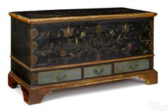 "Pook & Pook October. 3, 2015. Lot 362. Estimated: $8000 - $10000. Realized Price: $9600. Berks County, Pennsylvania painted pine dower chest, initialed MS 1813, with heart corners, and a tulip and floral front panel, having a three drawer base, with a blue surface, 28 1/4"" h., 48 1/2"" w."