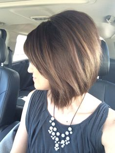 Aline haircut and soft brown and Carmel highlights. Aline Bob. Slant Bob.