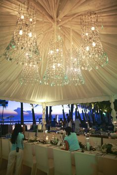 #chandeliers  looks like tomato cages  Photography: Aaron Ebio Ebsfoto - ebsfoto.com/ Event Planning + Floral Design: Boracay Weddings - boracayweddings.com.ph  Read More: http://stylemepretty.com/2011/08/25/discovery-shores-wedding-by-aaron-ebio-ebsfoto-mayad-studios/