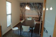 This natural-scened wallpaper creates a serene element to this boardroom.