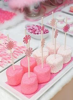 Sprinkled covered marshmallows with a sweet little flower top on the lolli sticks!