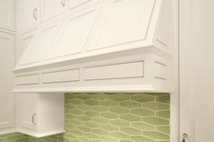 Mueller Nicholls: Lovely white and green kitchen with white kitchen cabinets and white wood paneled ...