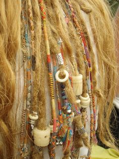 Wrapped dreadlocks with beads.