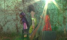 Spirit Ship: the girls on their journey, in the light. This Red Hook wall is no longer such an ethereal minty green....it has been painted by several artists.