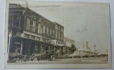 Whitesboro, Texas unused postcard with photo of Main Street, IOOF & Mason Lodges