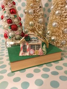 A personal favorite from my Etsy shop https://www.etsy.com/listing/556323107/putz-house-christmas-village-ornament-3