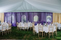 29a indian wedding reception tent with gold and purple draping and gold chiavari chairs