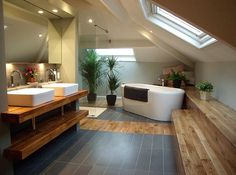 Timber and tile attic bathroom with large sky windows. #bathrooms #atticrooms