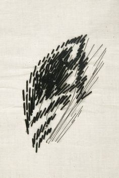 stitch test - exquisite . . . late 1960s, early 1970s - Scrap of calico with a large leaf shape at the centre drawn in sturdy black soft cotton thread with a thinner thread worked across one side in long stitches - straight stitch
