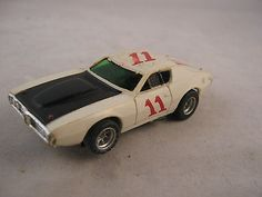 Vintage HO Scale Toy Slot Car AFX Singapore White Race Car #11 Black Hood - http://hobbies-toys.goshoppins.com/slot-cars/vintage-ho-scale-toy-slot-car-afx-singapore-white-race-car-11-black-hood/