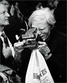 Andy Warhol with Polaroid by Ron Galella