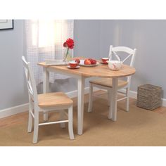 @Overstock.com - Country Cottage Drop Leaf Dining Set - Country Cottage Drop-leaf 3-piece Dining Set is perfect for small, intimate settingsLovely set features a round table and two matching chairsBoth table and chairs are made of tropical hardwood    http://www.overstock.com/Home-Garden/Country-Cottage-Drop-Leaf-Dining-Set/2481093/product.html?CID=214117  $219.99