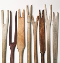 Antique carved wooden wash sticks dating from the late 19th to early 20th century