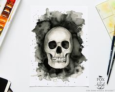 FREE PRINTABLE: Download this gorgeous watercolour skull in black and white, orange and purple colour schemes